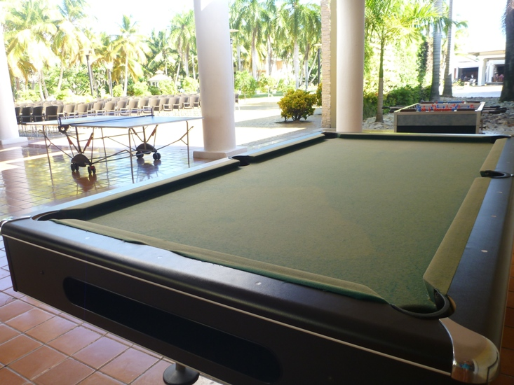 Pool and ping pong tables near theater